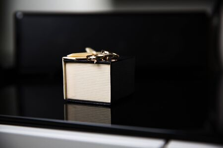 Photo for Bride and groom rings in wedding box on black background - Royalty Free Image