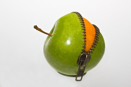 Photo pour Orange inside apple - image libre de droit