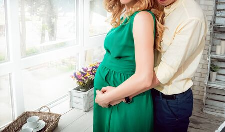 Young pregnant woman and her husband. Waiting baby