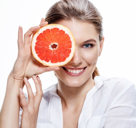 Photo for smiling brunette european woman with mottled orange slice - isolated on white background - Royalty Free Image