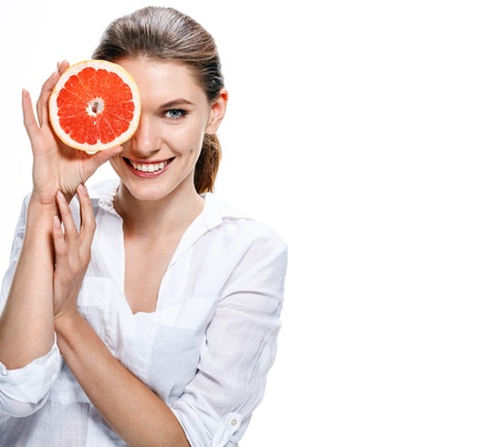 Photo for brunette european woman with orange slice - isolated on white background - Royalty Free Image
