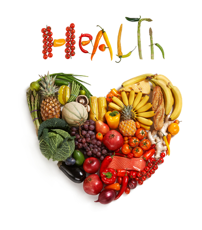 Photo pour Health food handbag - healthy food symbol represented by foods in the shape of a heart to show the health concept of eating well with fruits and vegetables - image libre de droit