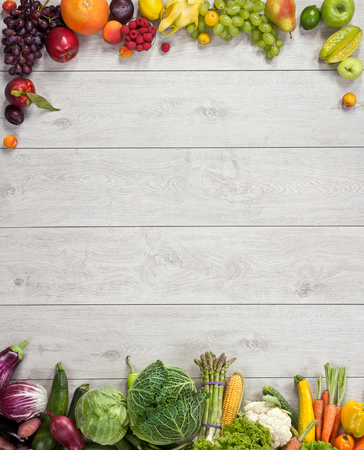 Foto de Healthy eating background - studio photography of different fruits and vegetables on wooden table - Imagen libre de derechos