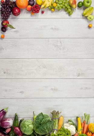 Photo pour Healthy food background - studio photography of different fruits and vegetables on wooden table - image libre de droit