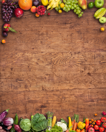 Photo pour Healthy food background - studio photography of different fruits and vegetables on old wooden table - image libre de droit