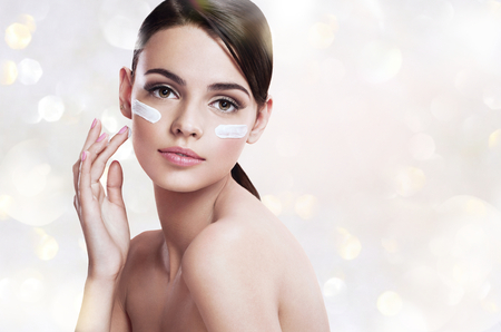 Photo for Skin care woman putting face cream - Royalty Free Image