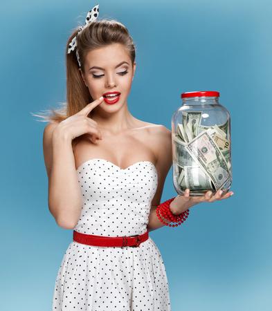 Photo pour Retro woman with a jar of money having an idea How to Spend Money. Shopping concept - image libre de droit