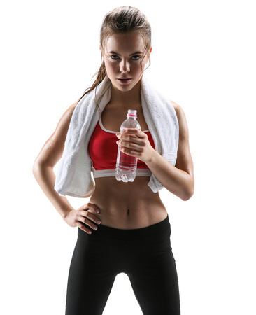 Photo for Beautiful girl with towel and bottle of water  photo set of sporty muscular female brunette girl wearing sports clothes over white background - Royalty Free Image