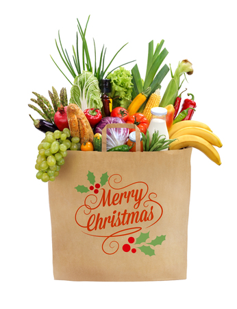 Foto de Merry christmas shopping bag, studio photography of brown grocery bag with fruits, vegetables, bread, bottled beverages - isolated over white background - Imagen libre de derechos