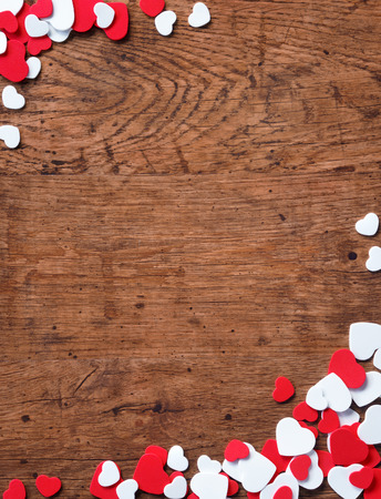 Photo for Valentines Day background with heap of small hearts on wooden background. - Royalty Free Image