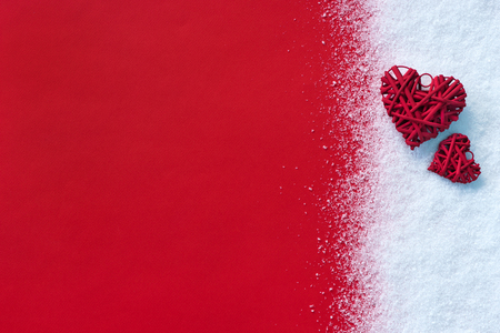 Foto de Beautiful romantic vintage red hearts on white snow winter and red background. - Imagen libre de derechos