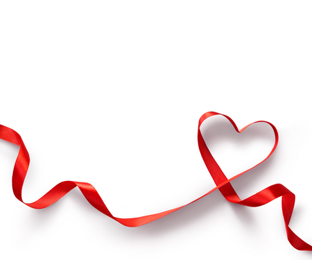 Foto de Red Ribbon Heart on white background - Imagen libre de derechos