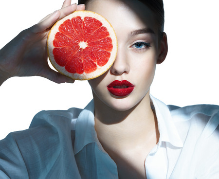 Photo for Lovely girl with pomelo slice - Royalty Free Image