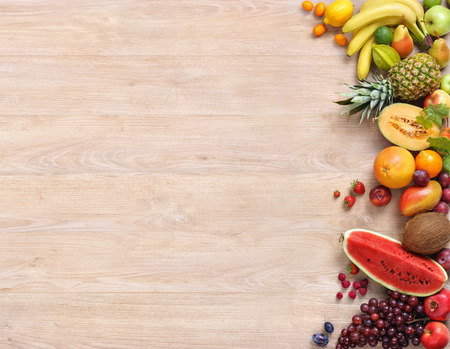 Photo pour Healthy food background, studio photography only fruits on wooden table - image libre de droit