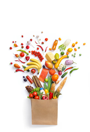 Foto de Healthy eating background, studio photography of different fruits and vegetables on white backdrop. Healthy food background, top view. High resolution product, - Imagen libre de derechos
