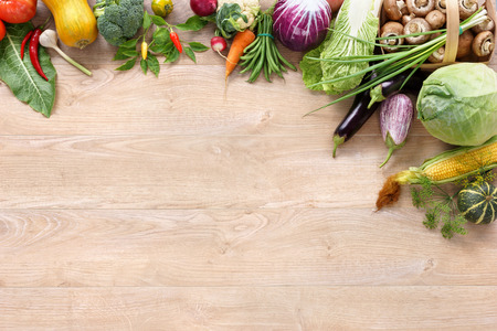 Photo pour Healthy food on wooden table. Top view with copy space high-res product, studio photography of different vegetables on old wooden table. - image libre de droit