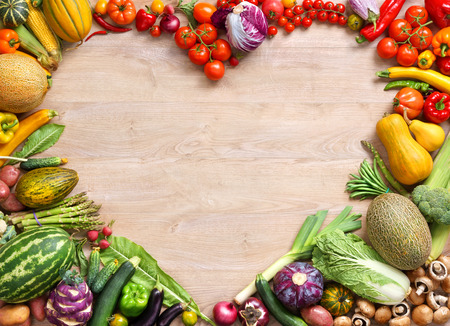 Photo pour Heart shaped food, food photography of heart made from different fruits and vegetables on wooden table - image libre de droit