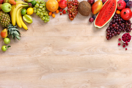 Photo for Healthy fruits background, studio photo of different fruits on wooden table - Royalty Free Image