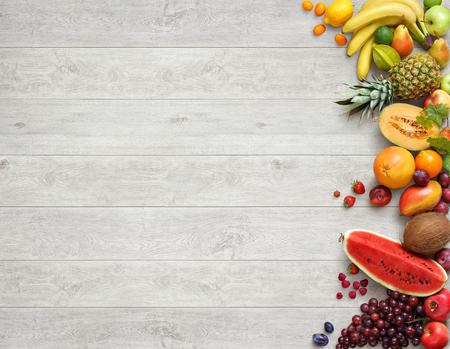 Foto de Healthy food background. Studio photo of different fruits on white wooden table. High resolution product. - Imagen libre de derechos