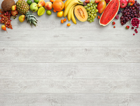 Photo pour Healthy food background. Studio photo of different fruits on white wooden table. High resolution product. - image libre de droit