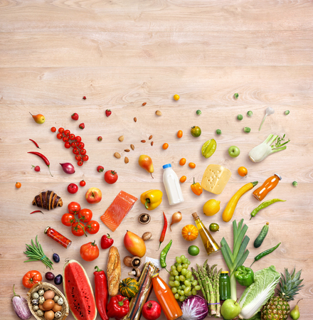 Photo for Healthy food background. Studio photo of different fruits and vegetables on wooden table. High resolution product, top view. - Royalty Free Image