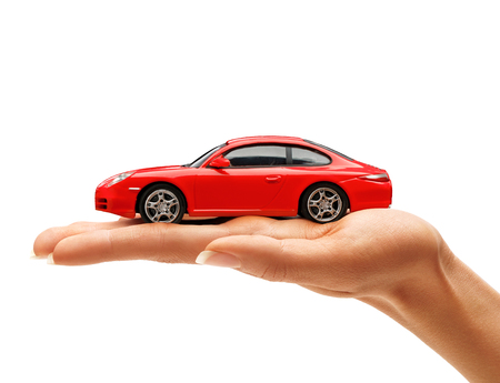 Photo pour Woman's hand holding a red toy car isolated on white background. Business concept - image libre de droit