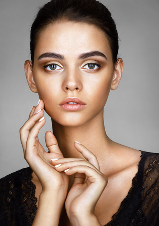 Photo pour Beautiful girl with beautiful make up. Photo of attractive brunette girl on grey background. Youth and skin care concept - image libre de droit