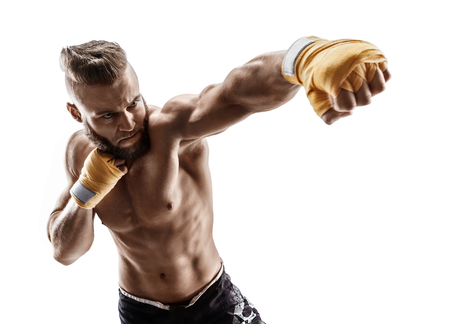 Foto de Man throwing a fierce and powerful punch. Photo of muscular man isolated on white background. Strength and motivation. - Imagen libre de derechos