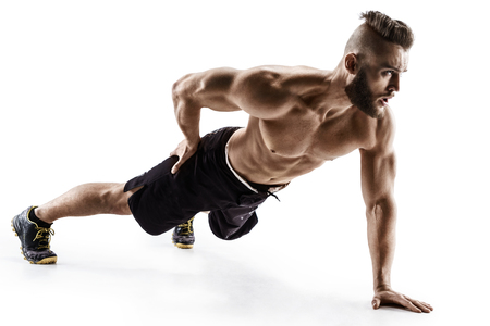 Foto de Attractive man doing push-ups exercises from the floor on the left arm. Photo muscular man isolated on white background. The strength and motivation - Imagen libre de derechos