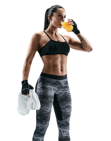 Foto de Resting time. Attractive young woman in sports wear holding towel and drink juice. Organic food and health concept. - Imagen libre de derechos