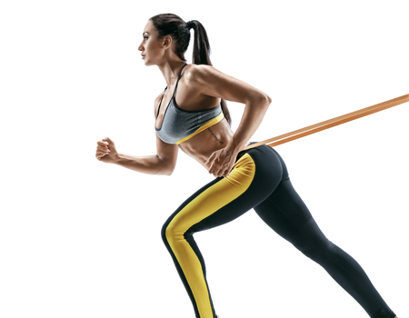 Photo for Attractive sporty girl during workout with suspension straps isolated on white background. Strength and motivation - Royalty Free Image