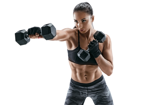 Photo for Sporty woman doing boxing exercises, making direct hit with dumbbells. Photo of muscular female wearing sportswear on white background. Strength and motivation - Royalty Free Image