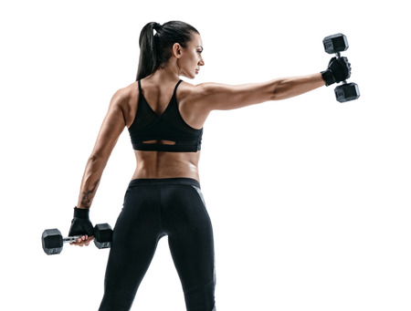 Photo for Strong woman  with dumbbells. Photo of sporty woman in sportswear on white background. Back view - Royalty Free Image