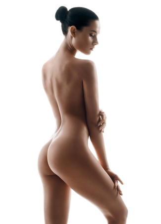 Foto de Silhouette of slender naked girl. Photo of woman body with perfect skin. Wellness and Spa concept - Imagen libre de derechos