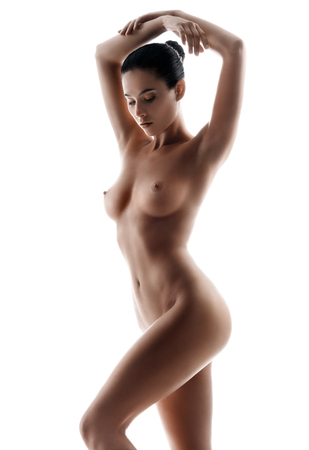 Foto de Slim tanned woman's body. Photo of perfect naked body on white background. Beauty and body care concept - Imagen libre de derechos
