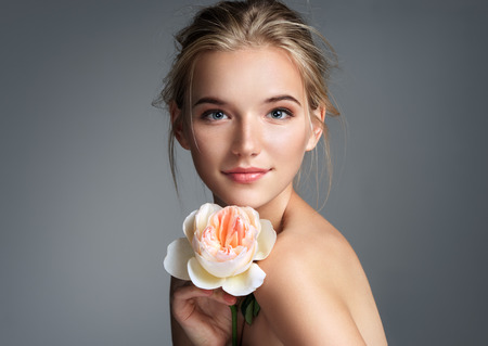 Photo for Beautiful girl with beautiful makeup. Photo of blonde girl with rose on grey background. Youth and skin care concept - Royalty Free Image