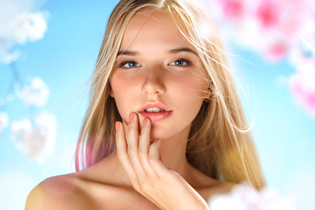 Photo pour Sensual young girl touching her lips. Youth and skin care concept. Spring - image libre de droit