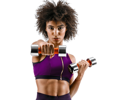 Photo pour Sporty girl doing boxing exercises, making direct hit with dumbbells. Photo of african girl on white background. Strength and motivation - image libre de droit