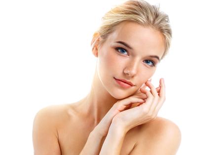 Foto de Charming young girl isolated on white background. Skin care concept - Imagen libre de derechos