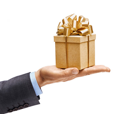 Foto de Man's hand in suit holding present isolated on white background. High resolution product. Close up - Imagen libre de derechos