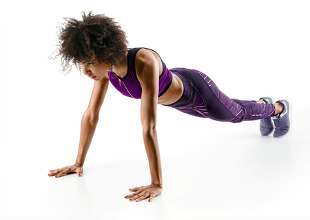 Photo for Strong girl doing push up. Photo of sporty african girl doing exercising isolated on white background. Strength and motivation - Royalty Free Image