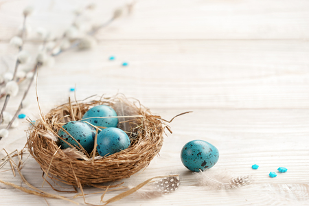 Foto de Easter background with Easter eggs and spring flowers. Top view with copy space. - Imagen libre de derechos