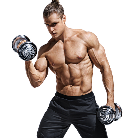 Foto de Sporttive man doing exercises with dumbbells at biceps. Photo of young man with naked torso and good physique isolated on white background. Strength and motivation. - Imagen libre de derechos