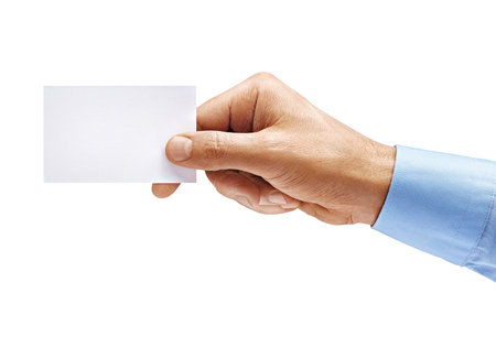 Foto de Man's hand in shirt holding empty business card isolated on white background. Close up. High resolution product - Imagen libre de derechos
