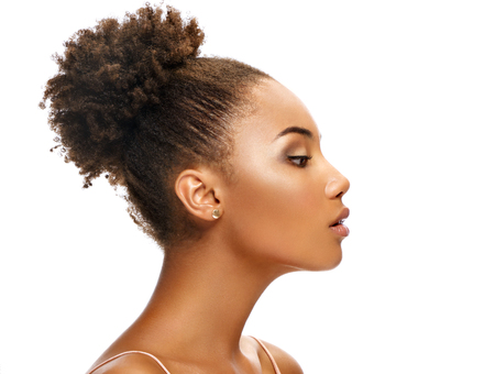 Foto de Young african girl in profile on white background. Youth and skin care concept - Imagen libre de derechos