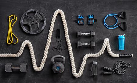 Foto de Sports equipment on a black background. Top view. Motivation - Imagen libre de derechos