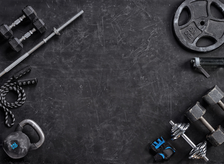 Foto de Sports equipment on a black background. Top view. Motivation - Imagen libre de derechos