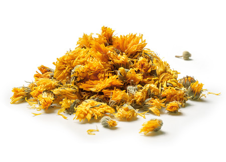 Photo for Heap of medicinal flowers of a calendula on white background. Herbal tea. Close up. High resolution - Royalty Free Image