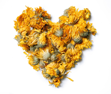 Photo for Heart shaped from medicinal flowers of a calendula isolated on white background. Herbal tea. Top view. Close up. High resolution - Royalty Free Image