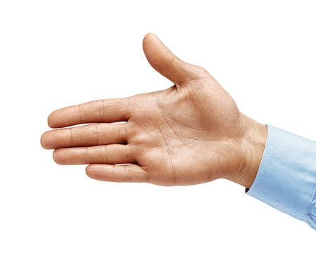 Foto de Man's hand in a shirt outstretched in greeting isolated on white background. Close up. High resolution product - Imagen libre de derechos